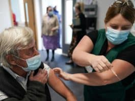 Vaccines May Relieve COVID 19 Symptoms, Patients Say; Researchers Are Probing The Claim